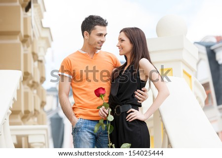 Loving couple. Cheerful young couple hugging while looking at each other - stock photo
