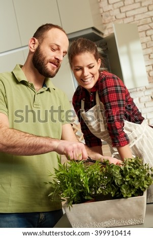 Loving couple cooking together in kitchen.