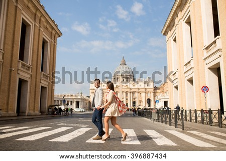 Loving couple crossing the street in Rome