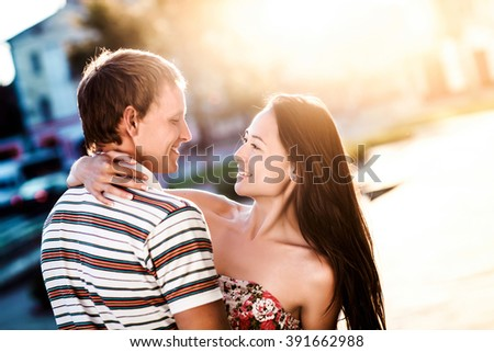 loving couple embraces on the street - stock photo