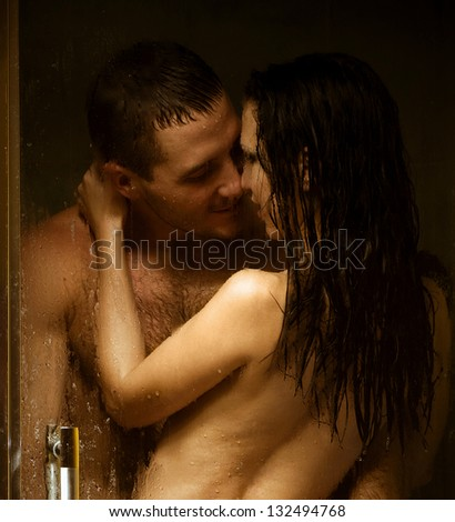 Loving couple engaged in love in a bath booth - stock photo
