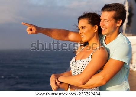 loving couple enjoying a cruise together - stock photo
