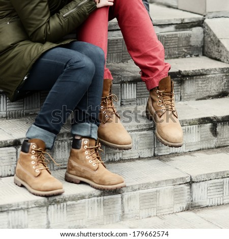 Loving couple feet in shoes closeup - stock photo