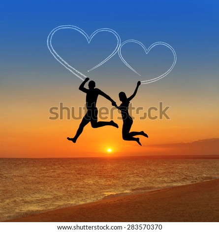 Loving couple flying at sky against sea beach and heart shaped vapour trail - happy valentines day concept - stock photo