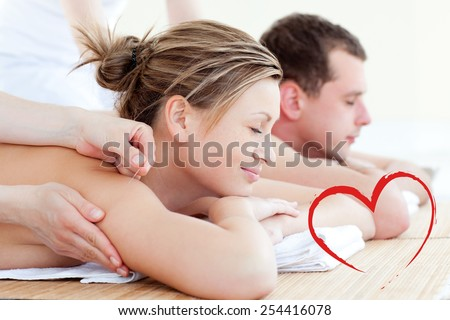 Loving couple having an acupunctre therapy against heart - stock photo