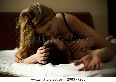 Loving couple having erotic moments in bedroom - stock photo