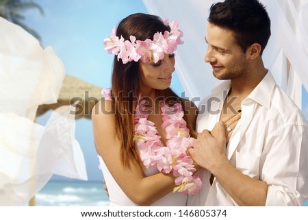 Loving couple having exotic wedding on tropical island. - stock photo