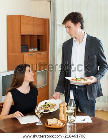 Loving couple having romantic dinner with wine  in home interior - stock photo