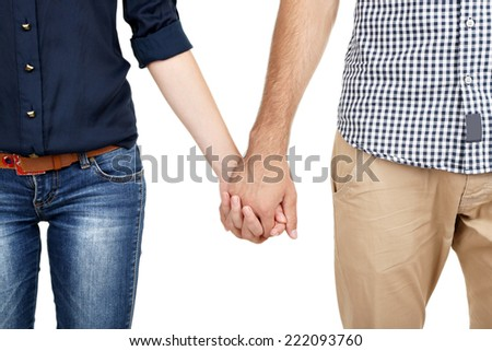 Loving couple holding hands isolated on white - stock photo