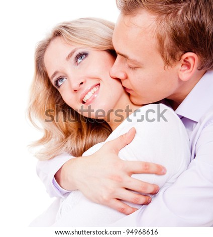 Loving couple hugging - isolated over a white background - stock photo