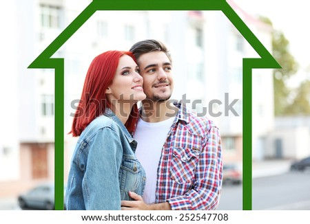 Loving couple in drawing house - stock photo