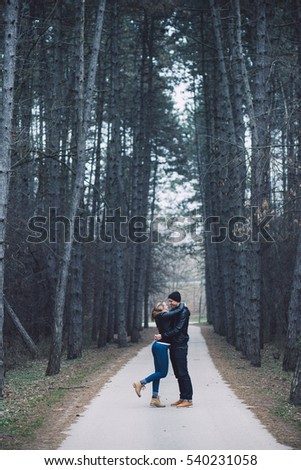 Loving couple in forest. Happy couple in love posing outdoor.