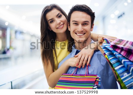 Loving couple in shopping mall - stock photo