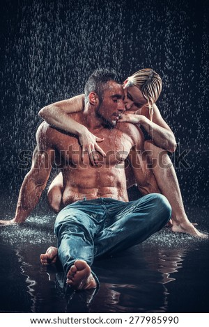 loving couple in the rain - stock photo