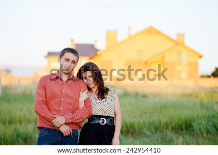 loving couple looking at their home - stock photo