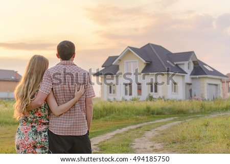 loving couple looking at their home. Copy space