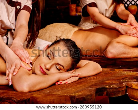 Loving couple  man and woman having oil Ayurveda spa treatment. - stock photo