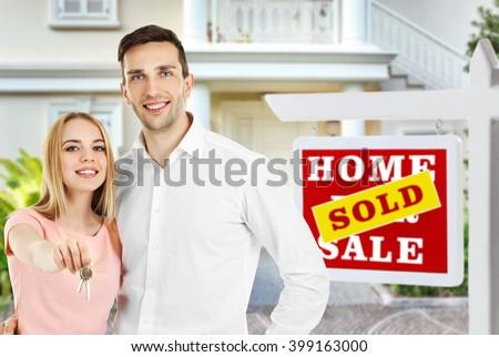 Loving couple near their house - stock photo
