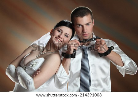 loving couple newlyweds in chains. always together. love. studio shooting is - stock photo