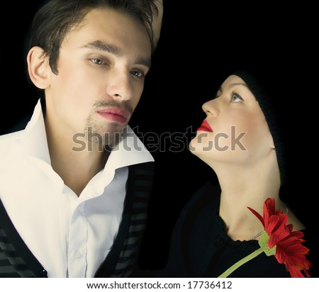 Loving couple on a black background