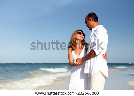 Loving couple on sandy beach. Romantic vacation