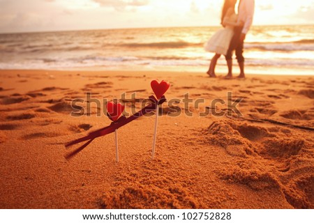 loving couple on the beach - stock photo