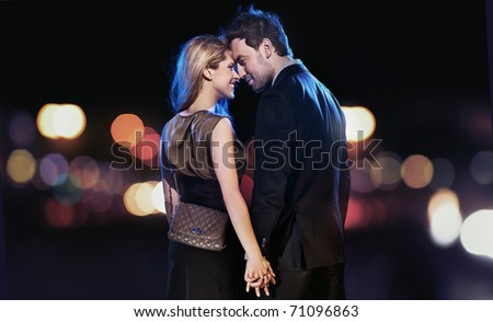 Loving couple on the night city background
