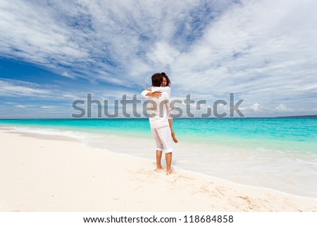 Loving couple on tropical beach - stock photo
