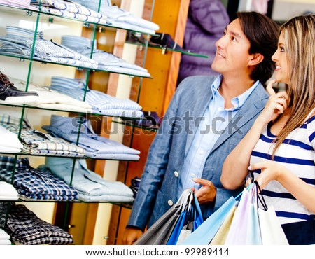 Loving couple shopping at a clothing store