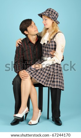 Loving couple sitting on the chair
