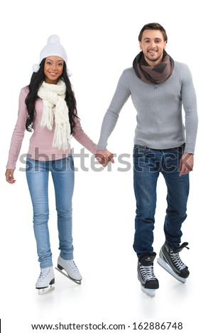 Loving couple skating together holding hands. Isolated on white  - stock photo