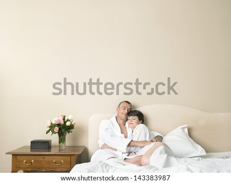 Loving couple sleeping together in bed