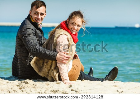 loving couple spending leisure time together at beach outdoor - stock photo