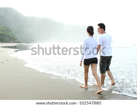 loving couple spending quality time with each other on beach - stock photo