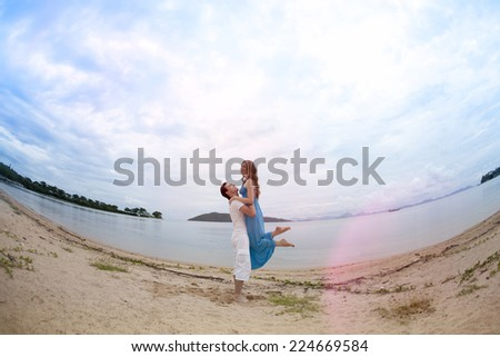 Loving couple. The guy and the girl at the sea.  - stock photo