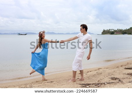 Loving couple. The guy and the girl at the sea.