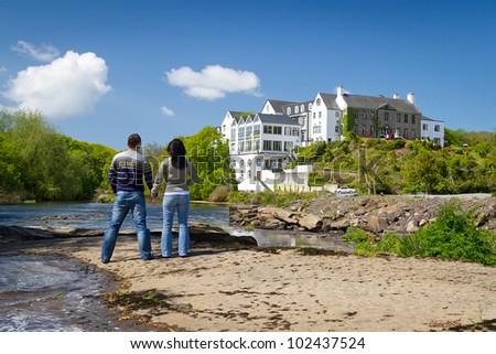 Loving couple together in Irish scenery - stock photo