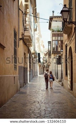 Loving couple walking down the street in Palma de Mallorca, Majorca, Balearic Islands, Spain - stock photo