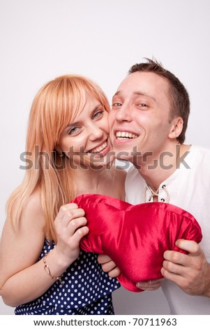 Loving couple with a big heart on white background
