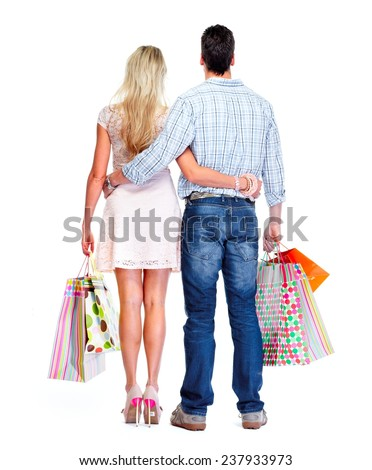 Loving couple with shopping bags isolated white background.