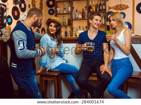 loving couples in a bar drinking and talking to each other. horizontal photo - stock photo