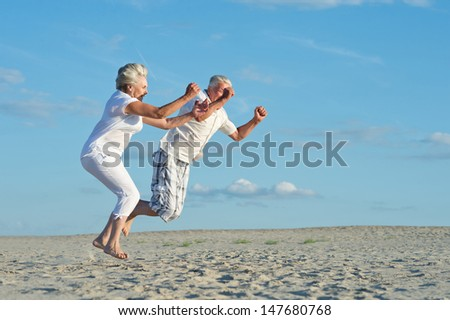 loving elder couple on a background of clear sky