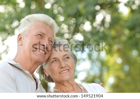 loving elderly couple on a walk in a summer park