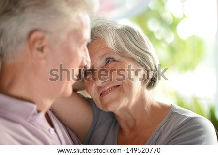 loving elderly couple spending time together at home - stock photo