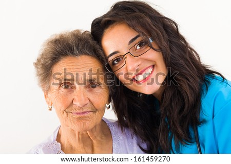 Loving family member doctor caring about elderly grandmother.  - stock photo