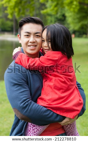 Loving father with daughter in the park - stock photo