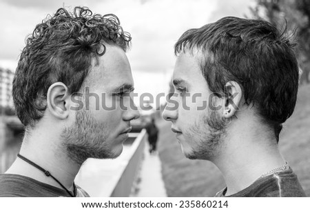 Loving gay couple in outsite. Blak and white photography - stock photo