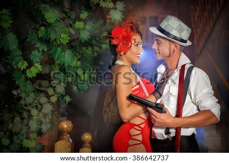 loving girl and the guy with the gun at the tree