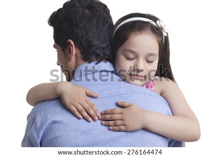 Loving girl embracing father against white background - stock photo