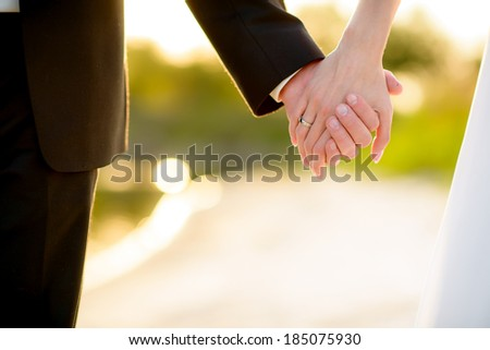 loving hands clasped of nature background - stock photo